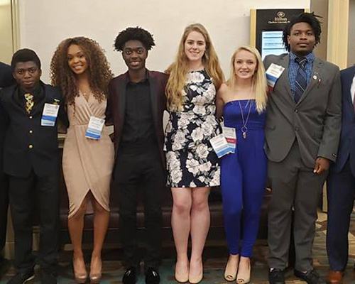 Four Louisburg College students placed high enough in a business competition to earn them a spot in a national competition in San Antonio, Texas.